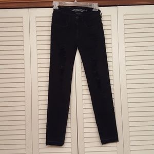 AMERICAN EAGLE OUTFITTERS BLACK DISTRESS JEGGINGS